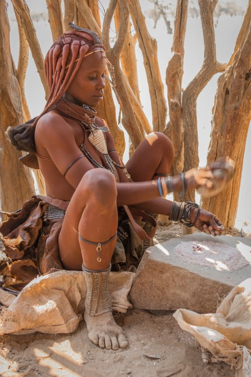 Himba Woman Grinding Corn